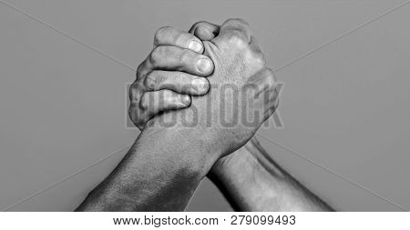 Man Hand. Two Men Arm Wrestling. Arms Wrestling. Closep Up. Friendly Handshake, Friends Greeting, Te