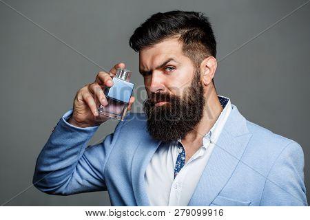 Man Perfume, Fragrance. Masculine Perfume. Male Fragrance And Perfumery, Cosmetics. Bearded Man Hold
