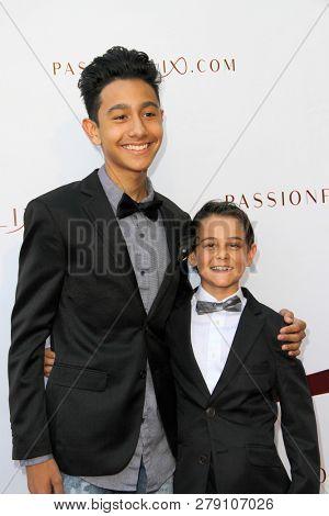 Julian Silva and Roman Coto attend the premiere of