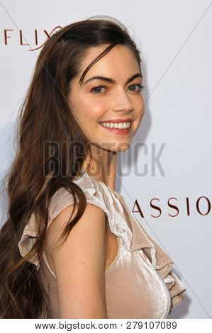 Caitlin Carver attends the premiere for