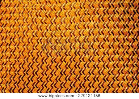 Close-up of the brown thin bamboo weave is a zig-zag pattern from Thai artisans on handmade in Thai art style, pattern and texture background poster