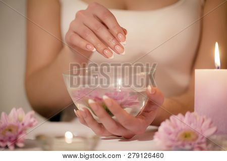Closeup Shot Of A Woman In A Nail Salon Receiving A Manicure By A Beautician With Cotton Wool With A