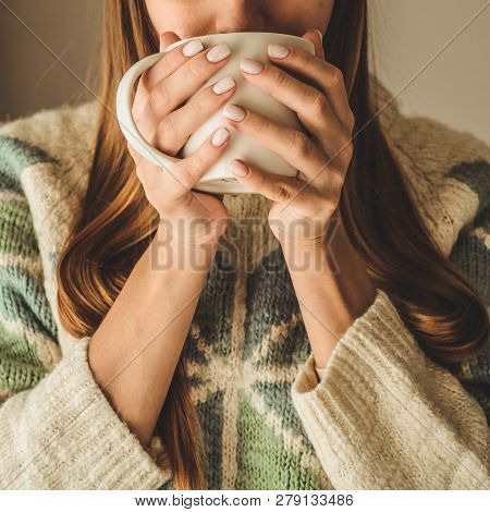 Cozy Home. Woman With Cup Of Hot Drink  By The Window. Looking At Window And Drink Tea. Good Morning