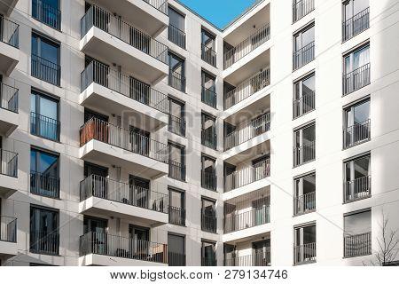 Balcony Facade On Corner Of Modern Apartment Building Complex -