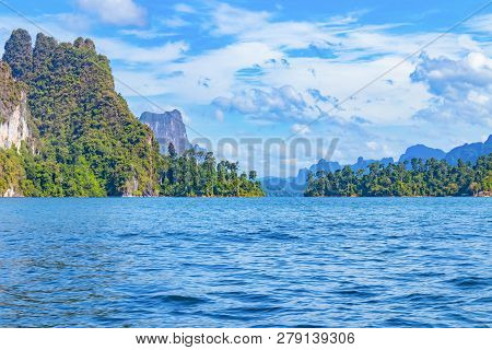 Landscape Natural View Mountain In Water Ratchaprapa Dam And Cheow Larn Lake, Khao Sok Nature Beauti