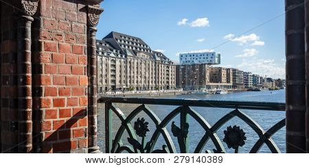 Panoramic view from Oberbaum bridge, Berlin, Germany. Blue sky, sun, ships a perfect destination for holidays. City background.