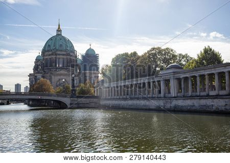 Berliner Dom, cathedral church on island museum in Berlin, Germany. Bridge in front and blue sky background.
