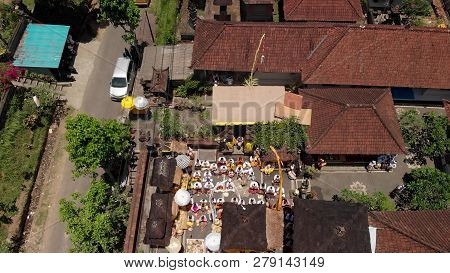 Aerial View Of Family Balinese Ceremony In A Small Village Close To Ubud Area. Hindu Traditional Cer