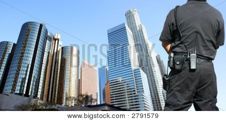 Security agent watching Los Angeles downtown area poster