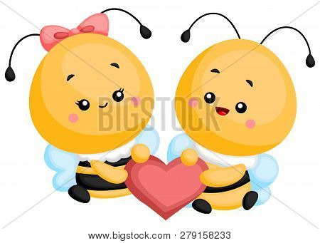A Couple Of Bees Holding A Heart