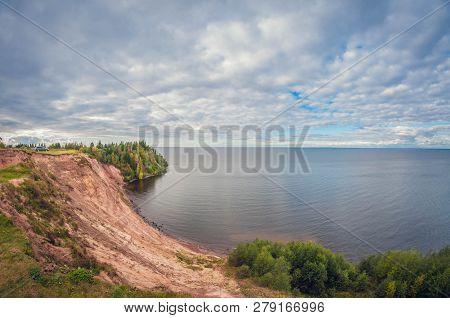Autumn Landscape. High Cliff On Lake. Autumn Landscape. High Cliff On The Lake. Car On The Edge Of C