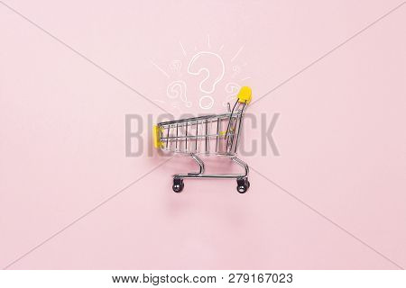 Shopping Trolley From The Supermarket On An Isolated Pink Background. Shopping In The Mall, Shop, Sh