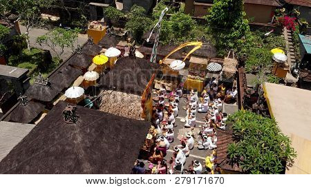Bali, Indonesia - October 3, 2018: Aerial View Of Family Balinese Ceremony In A Small Village Close