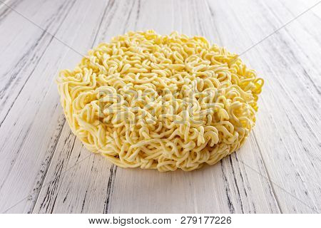 Side View Instant Noodles Or Dried Noodles On White Wood Background