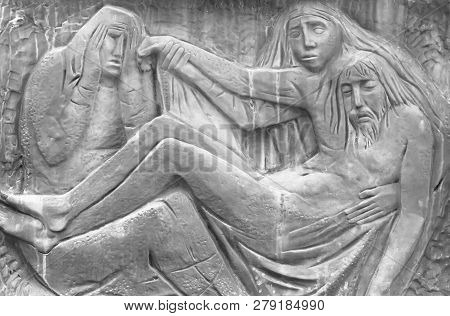 Bas-relief Representing The Pity Of Michelangelo. Holy Mary Mother And Jesus Christ After The Crucif