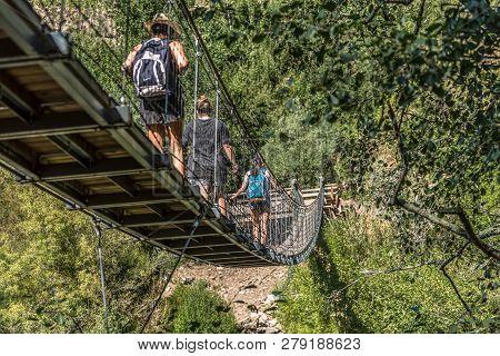 Arouca / Portugal - 10 12 2018 : View Of People Walking On Suspension Bridge On Pedestrian Walkway,