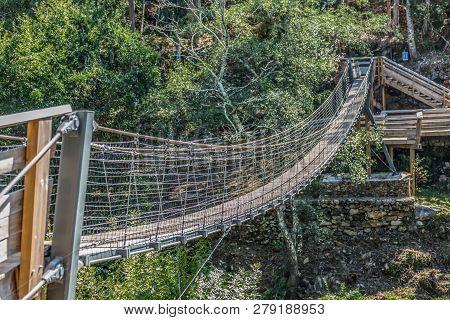 Suspension Bridge View On Pedestrian Walkway On Mountains, Overlooking The Paiva River, In Arouca, P
