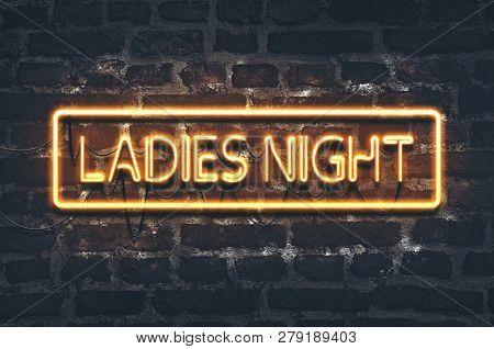 Ladies Night Neon Sign On Dark Brick Wall