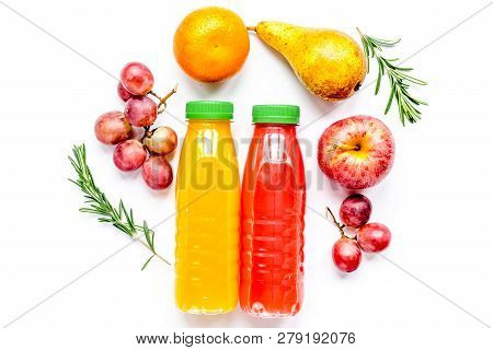 Bottles Of Smoothie With Fruits On White Table Top View Mock Up