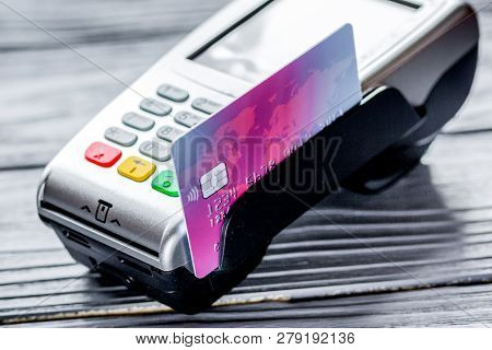 Payment With Credit Card Through Terminal On Gray Background