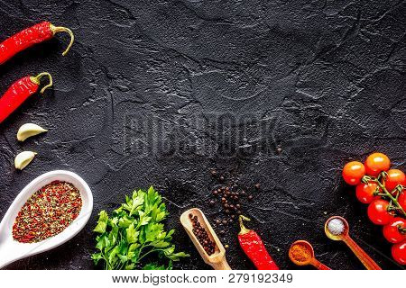 Spices In Wooden Spoon On Dark Background Top View