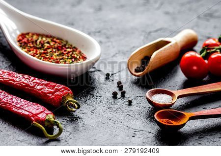 Spices In Wooden Spoon On Dark Background