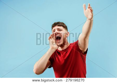 Do Not Miss. Young Casual Man Shouting. Shout. Crying Emotional Man Screaming On Blue Studio Backgro