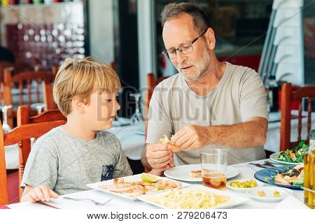 Family In The Restaurant, Father And Sun Eating Shrimps, Summer Vacation By The Sea