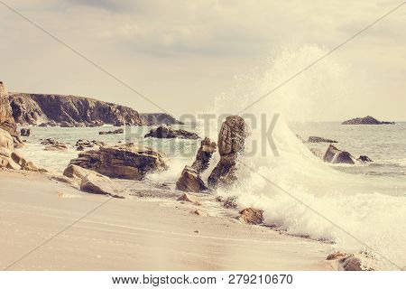 French Landscape - Water Games. A Beautiful Beach With Wild Cliffs In The Background At Sunset.