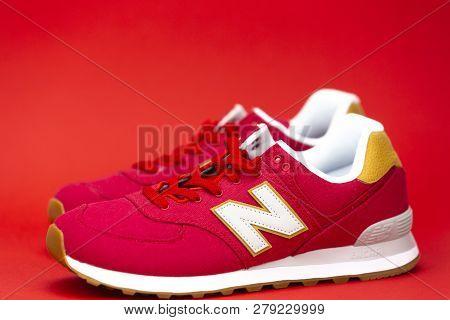 Boston, Ma, Usa, January 2019 - New Balance Nb 574 Athletic Shoes On Red Background. New Balance Ath