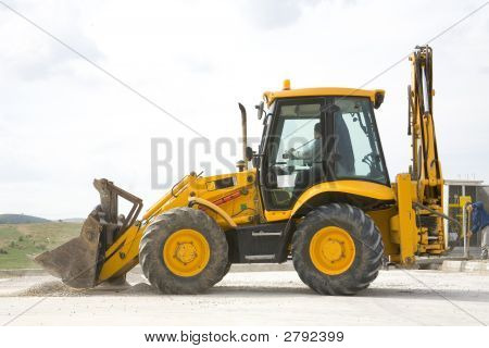 The Excavator And Operator Working In Factory