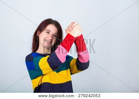 Happy Casual Young Woman Holding Both Hands Together Raised Up Showing Togetherness Symbol Like Enco