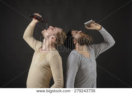 Used To Drink Alcohol. Hard Drinkers. Men Drinking Alcohol From Bottle And Flask. Alcohol Addicts. A