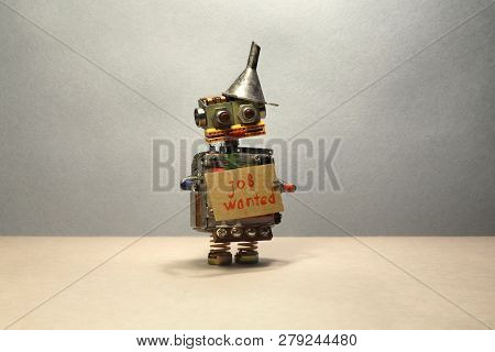 Job Search Concept. The Robot Wants To Get A Job. Funny Unemployed Toy Robot With A Cardboard Sign A