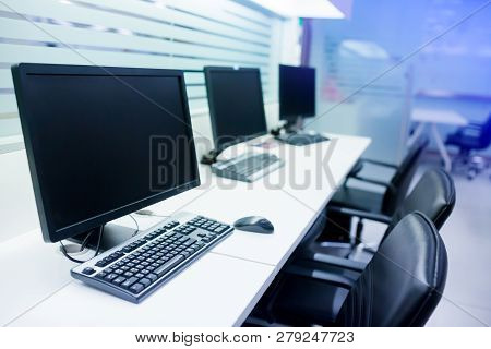 Composite Image Of Computer In Office Or Training Room