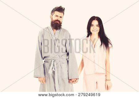 Couple In Love In Pajama, Bathrobe. Couple, Family On Smiling Faces In Clothes For Sleep Looks Sleep