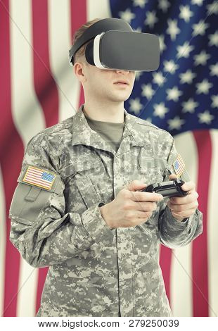 Indoors Close Up Shot Of Military Man Wearing Vr Goggles And Controller In Hands