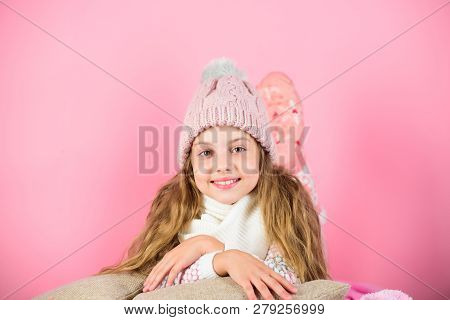 Warm Accessories That Will Keep You Cozy This Winter. Kid Girl Wear Knitted Hat Relaxing Pink Backgr