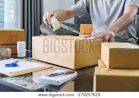 Small Business Parcel For Shipment To Client, Young Entrepreneur Sme Freelance Man Working With Pack