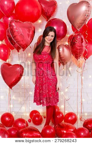 Beautiful Young Woman In Red Dress With Heart-shaped Balloons