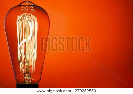 Vintage Light Bulb, On Bright Red Background. Abstract Composition. Old Style. Idea!!! Place For You