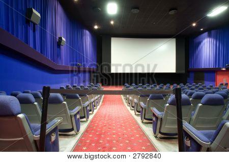 Empty Cinema Auditorium With Black Cordon