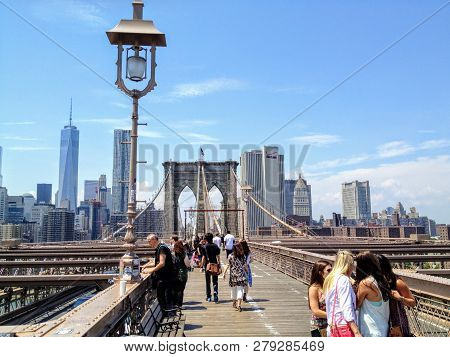 New York City, New York, United States -june 25th, 2014: Several Groups Of People Crossing The Pedes