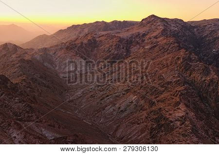 Scenic landscape in the mountains at sunrise. Amazing view from Mount Sinai (Mount Horeb, Gabal Musa, Moses Mount). Sinai Peninsula of Egypt. Pilgrimage place and famous touristic destination. poster