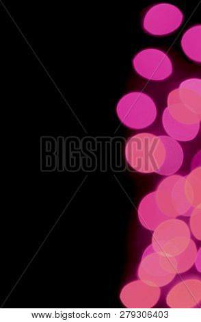 Vertical Image Of Abstract Blurred Decorated Lighting In Vivid Pink Color Gradations On Black Backgr