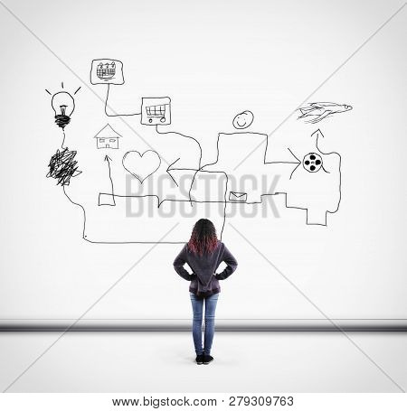 Young Woman Looks Up To Different Arrows Pointing Icons.