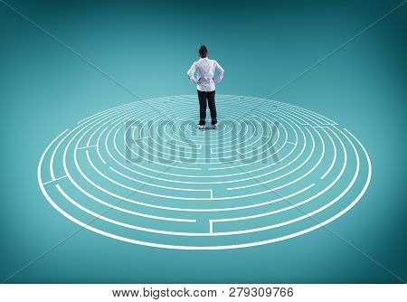 Young Man Stands In The Middle Of A Maze