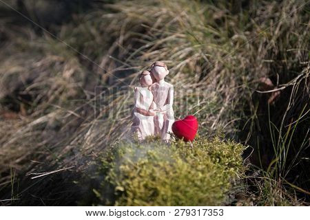 Miniature Of A Women And A Man In Love Sitting On Heart Sign Bench With Bokeh Light Copyspace, Coupl