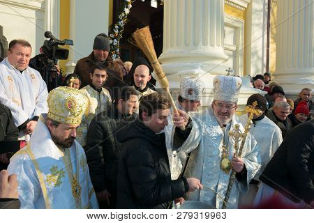Uzhgorod, Ukraine - Jan 19, 2019: Greek Catholic Epiphany Ceremony In Cathedral. Priest Sanctifies P