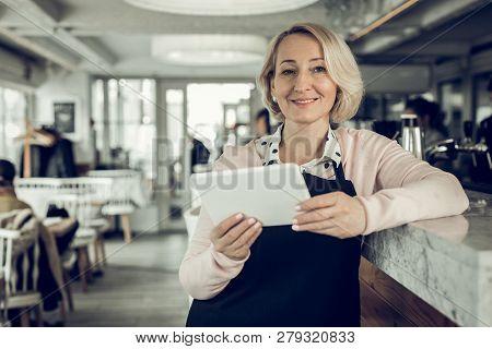 Blonde-haired Entrepreneur Owing Restaurant Holding Little White Tablet
